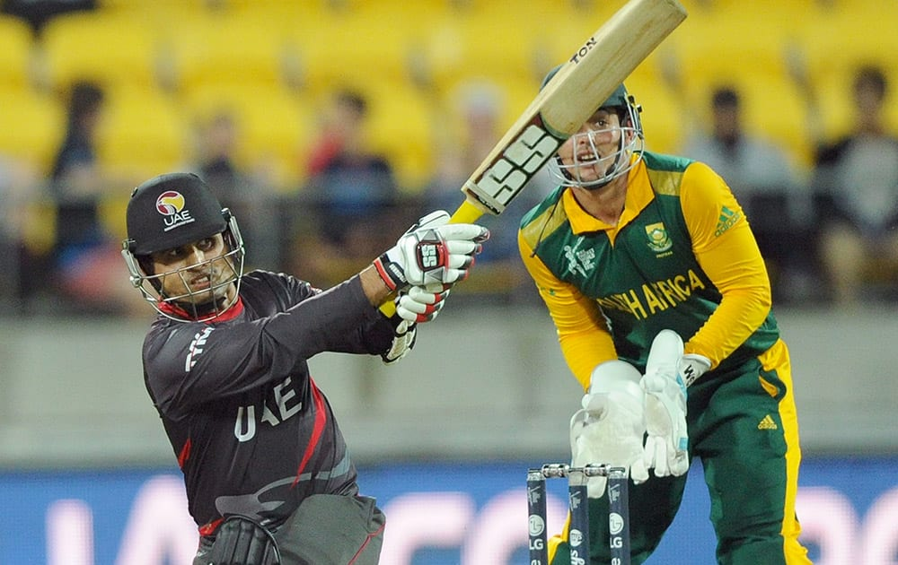 United Arab Emirates batsman Shaiman Anwar plays a shot as South African wicketkeeper Quinton De Kock watches during their Cricket World Cup Pool B match in Wellington, New Zealand.