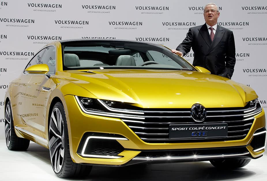 Volkswagen CEO Martin Winterkorn poses for the media beside a GET concept car prior to the company's annual press conference in Berlin, Germany.