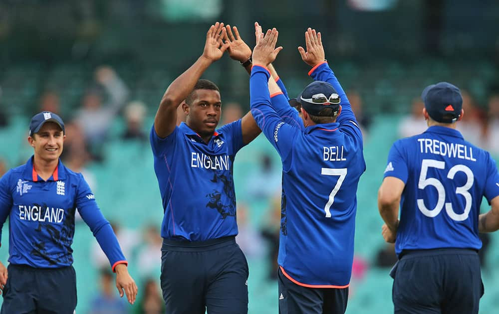 England's Chris Jordan, second left, celebrates with teammates after dismissing Afghanistan's Afsar Zazai during their Cricket World Cup pool A match in Sydney.