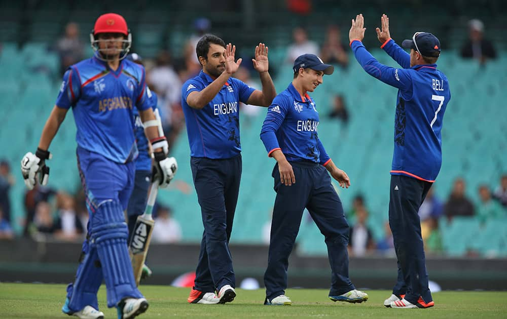 England's Ravi Bopara, celebrates with teammates after dismissing Afghanistan's Jamal Nasir, left, during their Cricket World Cup pool A match in Sydney.