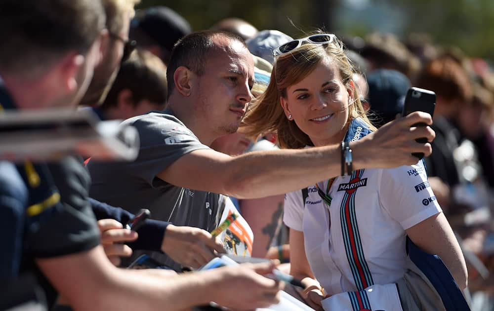 Williams Formula One test driver Susie Wolff of Britain has a selfie photo taken with a fan as she arrives at Albert Park circuit ahead of the Australian Formula One Grand Prix in Melbourne, Australia.