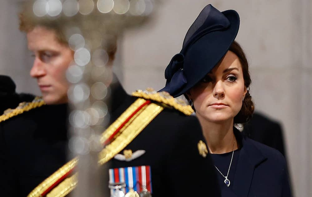 Britain's Kate, the Duchess of Cambridge stands near Prince Harry as they arrive to attend the Service of Commemoration – Afghanistan, at St Paul's Cathedral in London.