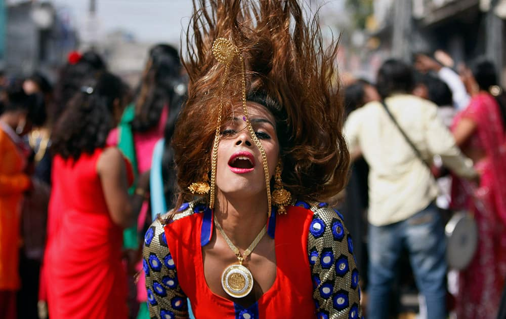A eunuch dances during a rally to mark the congregation of thousands of eunuchs from different parts of India, in Jammu.
