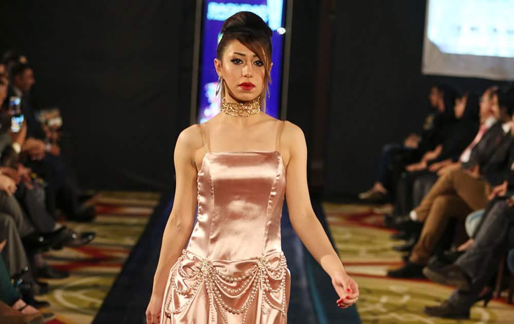 A model displays a dress designed by Iraqi designer Senan Kamil during a fashion show at Baghdad's al-Rasheed Hotel.