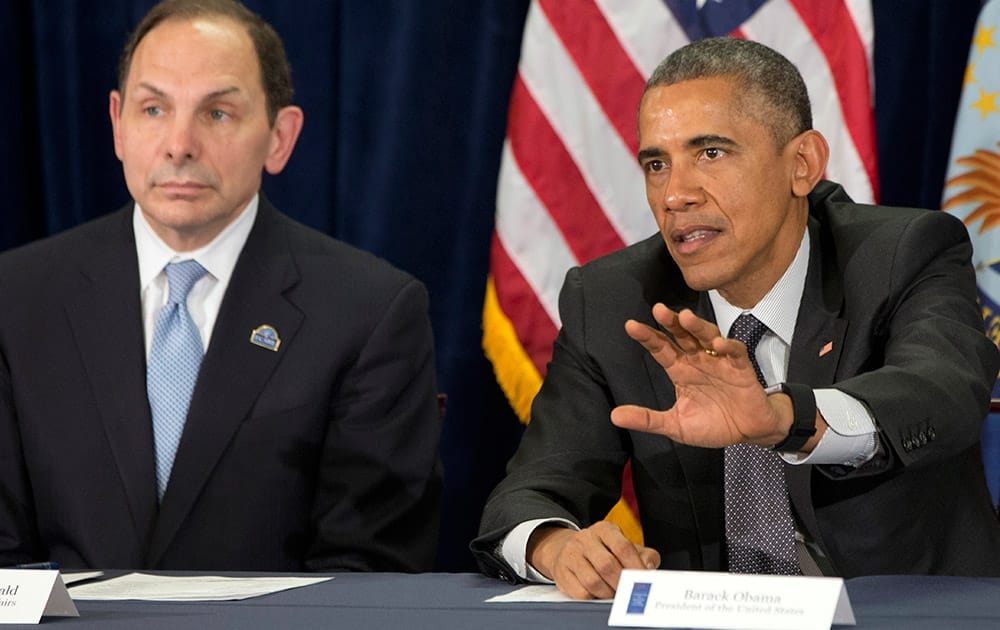 President Barack Obama speaks next to new VA Secretary Robert McDonald during a meeting on veterans issues at the Phoenix VA Medical Center.