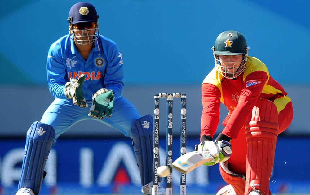Zimbabwe batsman Brendan Taylor plays a reverse sweep shot as Indian wicketkeeper MS Dhoni watches during their Cricket World Cup Pool B match in Auckland, New Zealand.