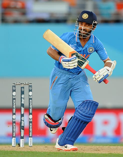 Ajinkya Rahane runs down the wicket while batting against Zimbabwe during their Cricket World Cup Pool B match in Auckland, New Zealand.