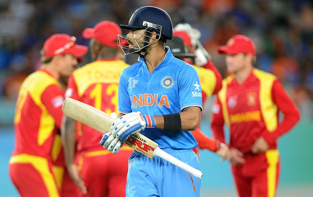 Virat Kohlin walks from the field after he was dismissed for 38 runs while batting against Zimbabwe during their Cricket World Cup Pool B match in Auckland, New Zealand.