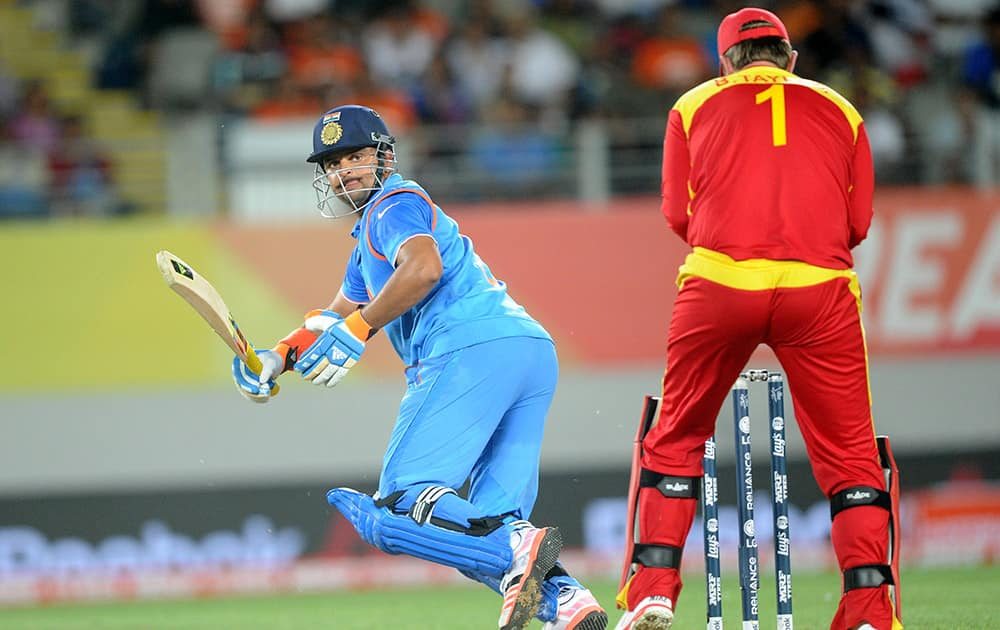 Suresh Raina plays a shot behind Zimbabwe wicketkeeper Brendon Taylor, during their Cricket World Cup Pool B match in Auckland, New Zealand.
