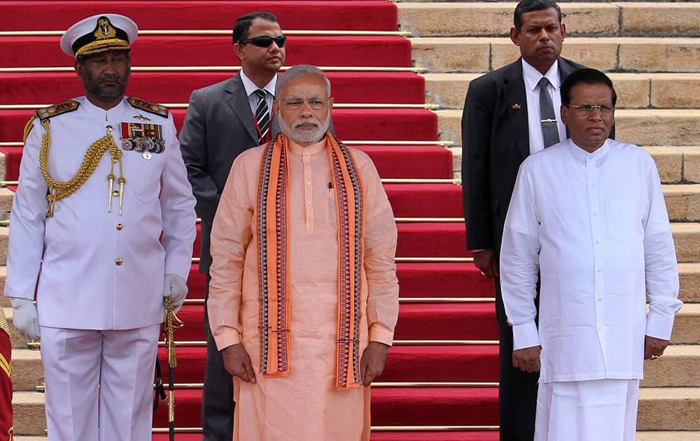 Prime Minister Narendra Modi stands with Sri Lanka's President Maithripala Sirisena as he attends his ceremonial reception in Colombo, Sri Lanka.