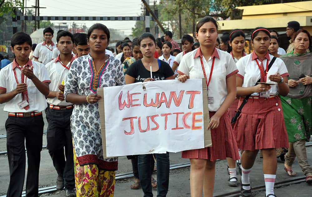 Students of Convent of Jesus and Mary School participate in a protest against the gang rape of a nun in her 70s by a group of bandits when she tried to prevent them from robbing the Christian missionary school in Begopara, about 80 kilometers (50 miles) northeast of Kolkata.