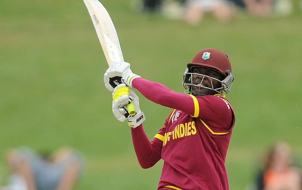 West Indies batsman Jonathan Carter hits the ball while batting against the United Arab Emirates during their Cricket World Cup Pool B match in Napier, New Zealand.