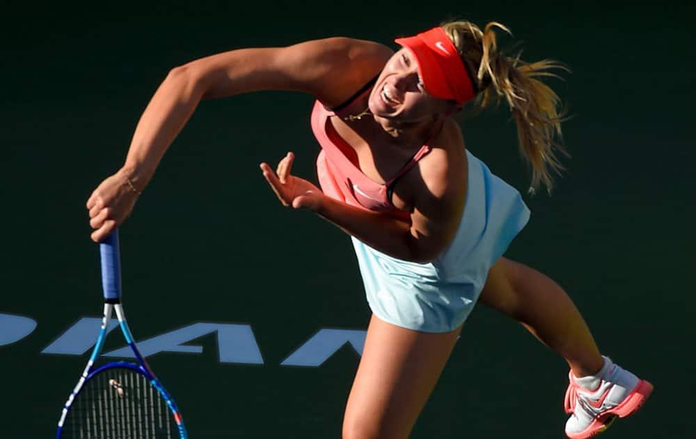Maria Sharapova, of Russia, serves to Yanina Wickmayer, of Belgium, during their match at the BNP Paribas Open tennis tournament.