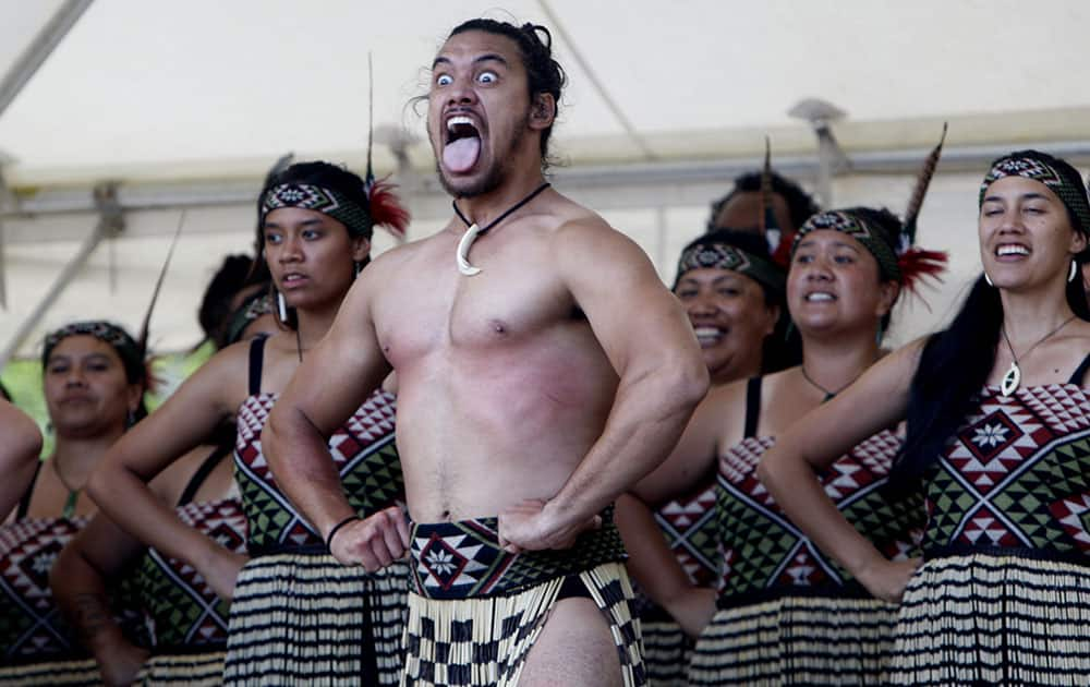 Indigenous Maori perform, in Waitangi, New Zealand, to mark the 175th anniversary of the signing of the country's founding document, the Treaty of Waitangi.