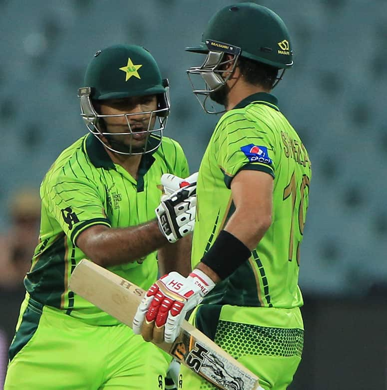 Pakistan's Sarfraz Ahmed, left congratulates teammate Ahmed Shahzad, for his fifty runs during their Cricket World Cup Pool B match against Ireland in Adelaide, Australia.