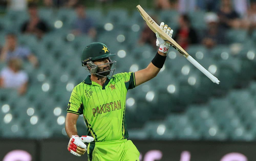 Pakistan's Ahmed Shahzad, acknowledges his fifty runs during their Cricket World Cup Pool B match against Ireland in Adelaide, Australia.