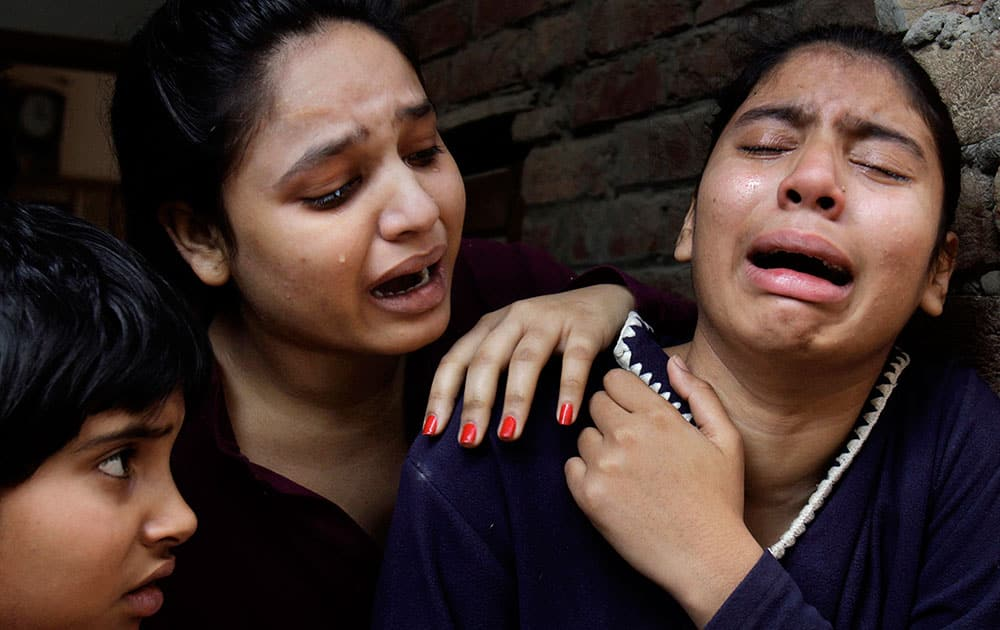 Pakistani Christian girls mourn over a family member who was killed from a suicide bombing attack near two churches in Lahore, Pakistan.