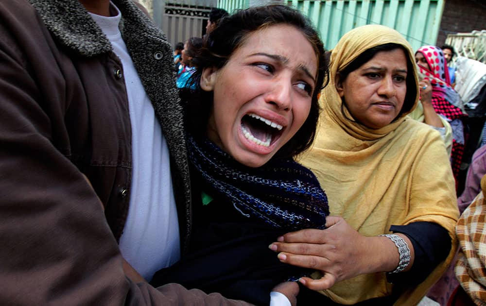 A Pakistani Christian woman mourns over a family member who was killed from a suicide bombing attack near two churches in Lahore, Pakistan.