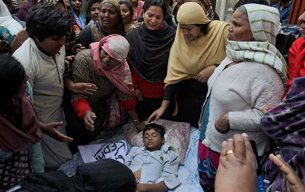 A Pakistani Christian family mourn over the lifeless body of a boy who was killed from a suicide bombing attack near two churches in Lahore, Pakistan.