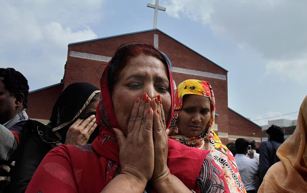 Pakistani Christian women mourn as they gather at a church damaged from a suicide bombing attack in Lahore, Pakistan.