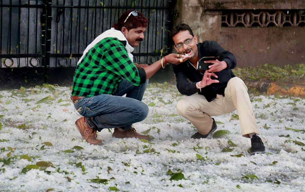 People click selfies after a spell of heavy hailstorm in Nagpur.
