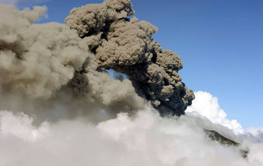 a column of ash and smoke erupts from the Turrialba volcano in Turrialba, Costa Rica.