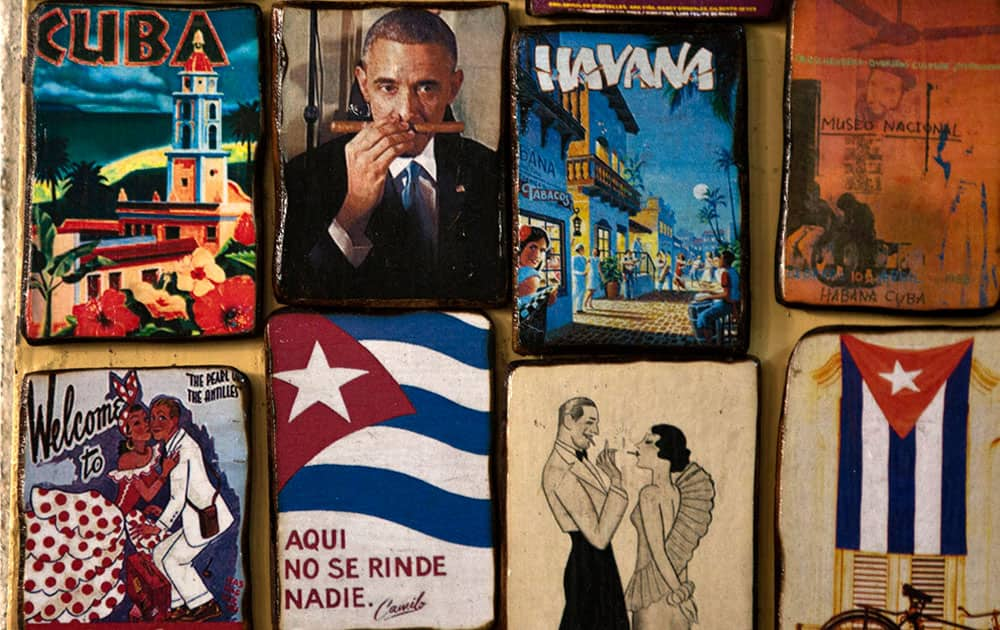 Magnets for sale decorate a tourist shop, one showing an image of U.S. President Barack Obama smelling a cigar, at a market in Havana, Cuba.