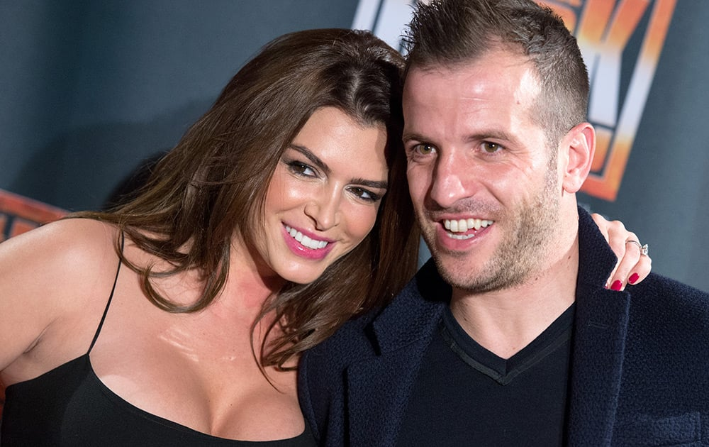 Soccer player Rafael van der Vaart and his girlfriend Sabia Boulahrouz arrive for the premiere of the Queen Musical 'We Will Rock You' in the Mehr! theatre in Hamburg, Germany.