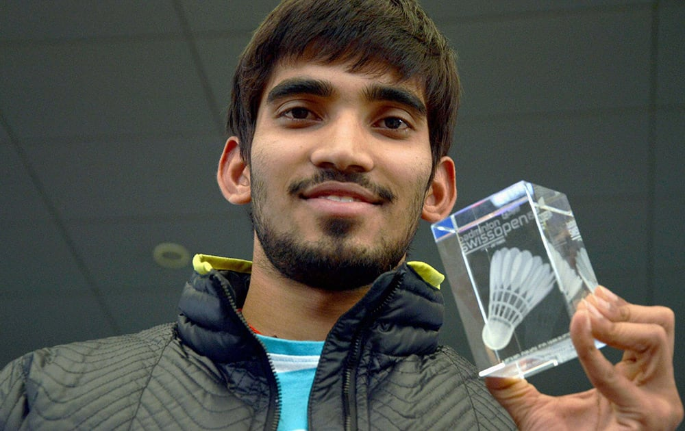 Ace shuttler Kidambi Srikanth, winner of Swiss Open Grand Prix Gold 2015 trophy, on his arrival at Shamshabad Airport near Hyderabad from Switzerland.