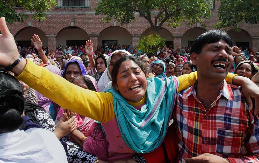 Pakistani Christians mourn during the mass funeral service of the victims of Sunday's pair of suicide attacks on two churches in Lahore, Pakistan.