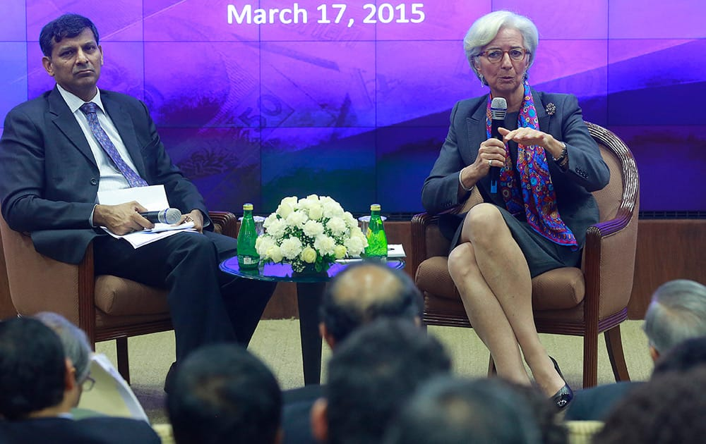 Managing Director of the International Monetary Fund Christine Lagarde speaks as Governor of Reserve Bank of India (RBI) Raghuram Rajan looks on during an event at the RBI headquarters in Mumbai.