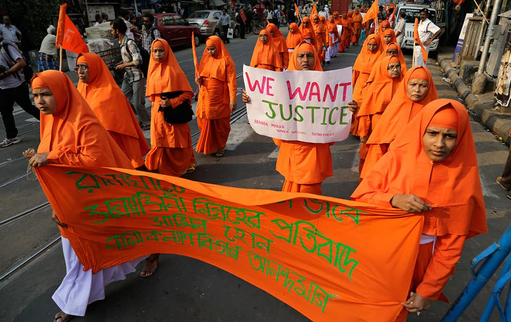 Nuns of Ananda Marga, a spiritual and social service organization, walk in a silent procession protesting the rape of an elderly nun at a convent in Ranaghat, in Kolkata.