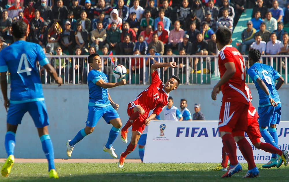 India's Sunil Chhetri competes for the ball with Nepal's Bikram Lama during their 2018 World Cup qualifying match in Kathmandu, Nepal.