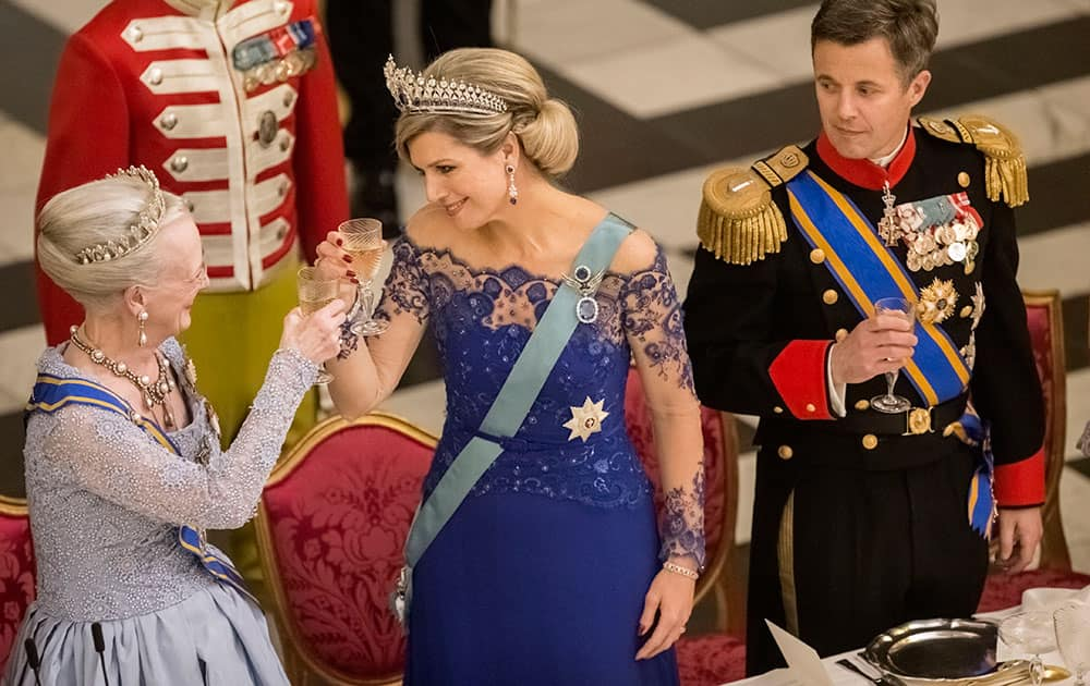 Denmark's Queen Margrethe, left, Queen Maxima of the Netherlands, and Denmark's Crown Prince Frederik toast during a Gala Dinner at Christiansborg Palace, in Copenhagen, Denmark.