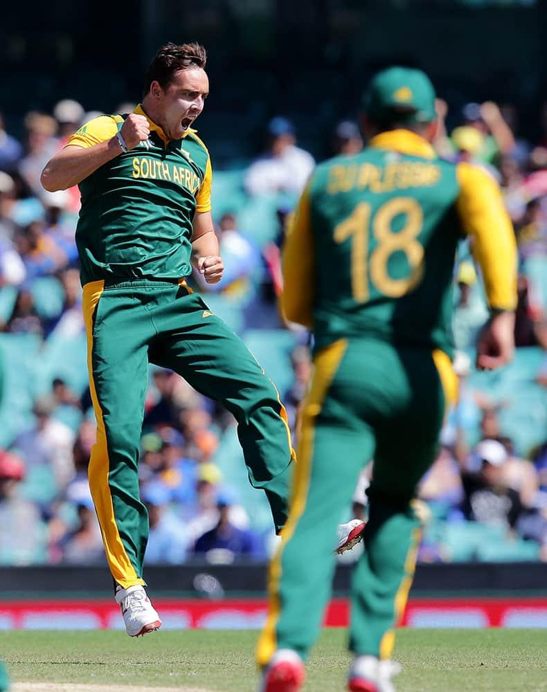 South Africa's Kyle Abbott celebrates the dismissal of Sri Lanka's Kusal Perera during their Cricket World Cup quarterfinal match in Sydney, Australia.