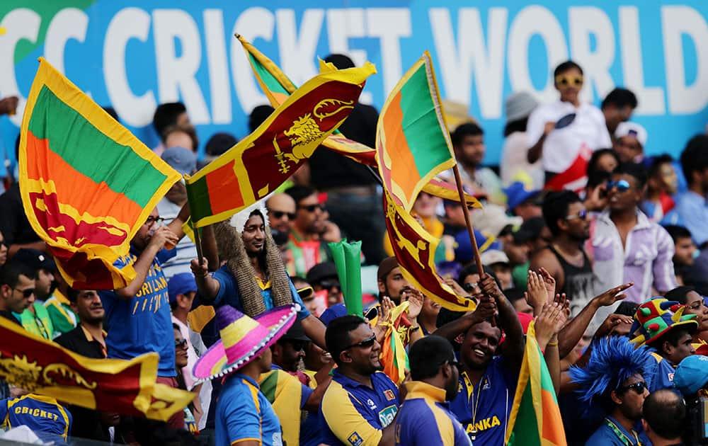 Sri Lankan fans cheer their team on during their Cricket World Cup quarterfinal match against South Africa in Sydney, Australia.