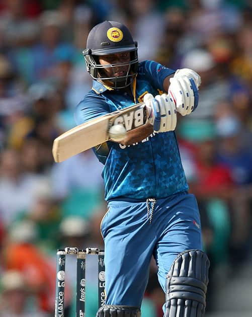 Sri Lanka's Angelo Mathews hits the ball while batting against South Africa during their Cricket World Cup quarterfinal match in Sydney, Australia