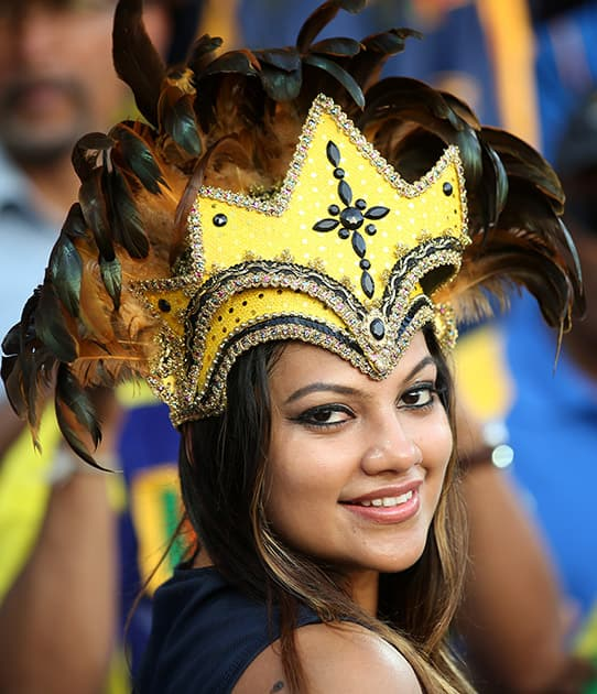A Sri Lankan fan watches her team's Cricket World Cup quarterfinal match against South Africa in Sydney.