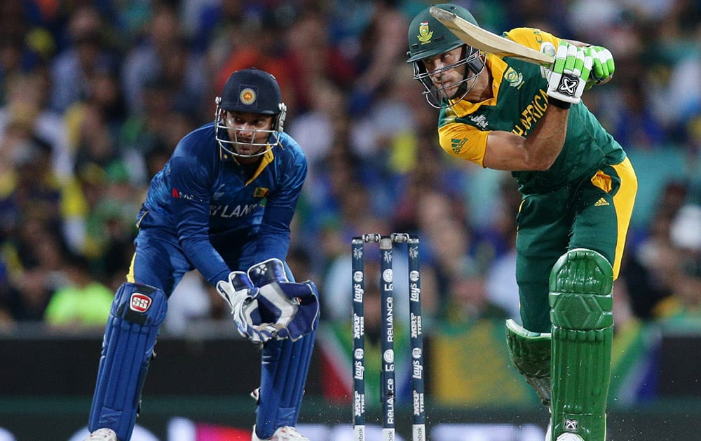 South Africa's Francois Du Plessis plays a shot as Sri Lanka's wicketkeeper Kumar Sangakkara watches during their Cricket World Cup quarterfinal match in Sydney.