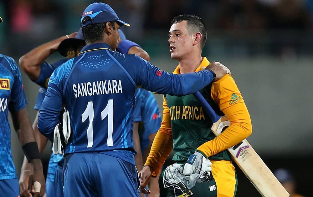 Sri Lanka's Kumar Sangakkara talks with South African batsman Quinton De Kock after South Africa's nine wicket win in their Cricket World Cup quarterfinal match in Sydney, Australia.