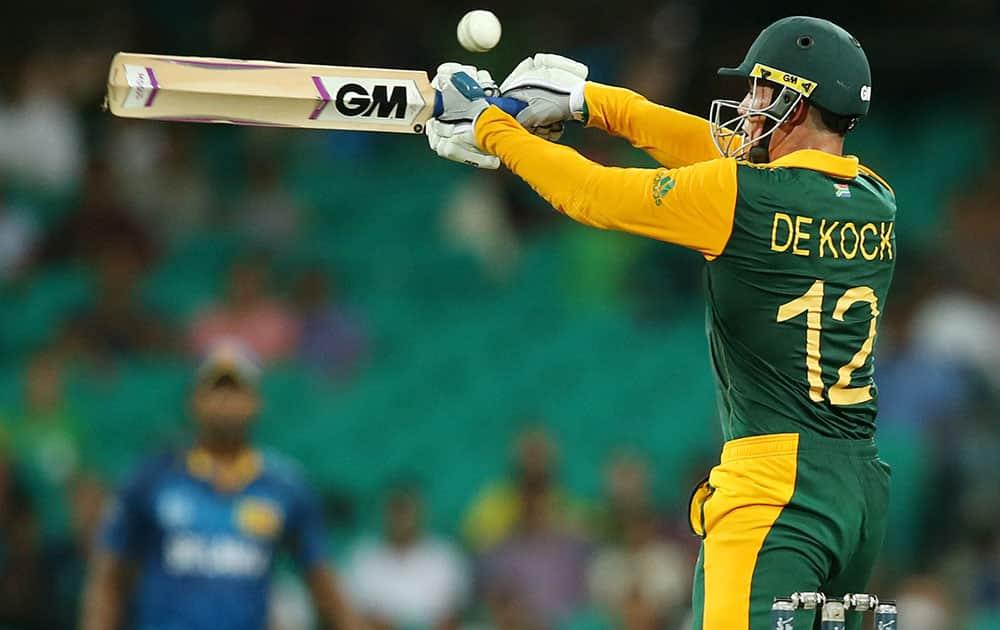 South African batsman Quinton De Kock swings at the ball during their Cricket World Cup quarterfinal match against Sri Lanka in Sydney, Australia.