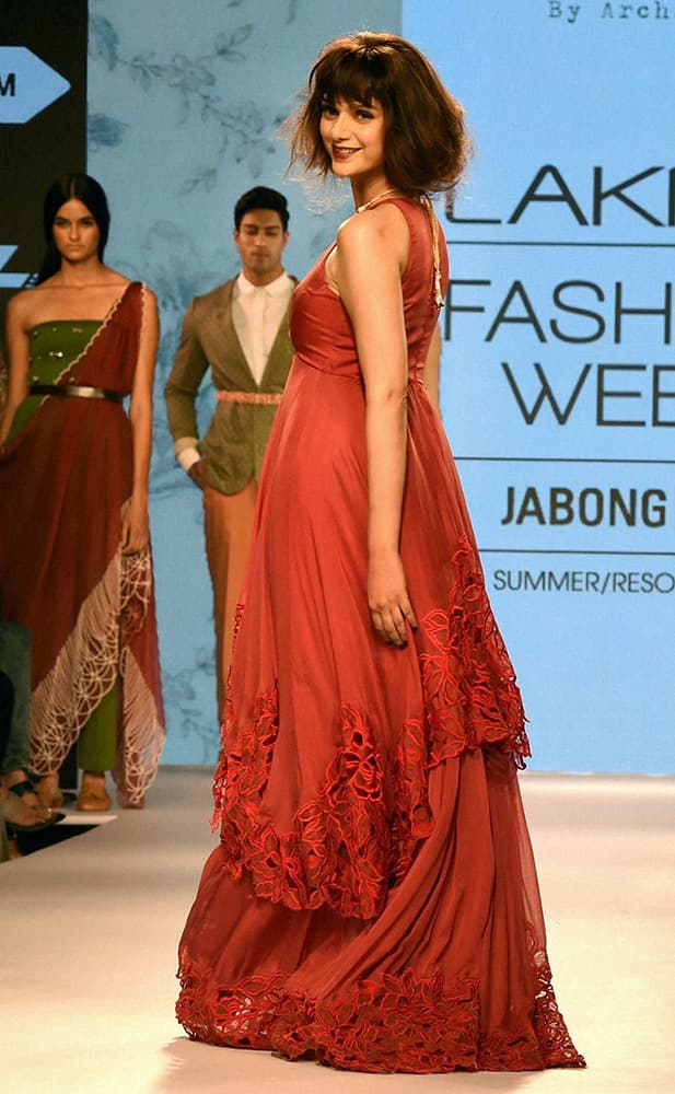 Bollywood actress Aditi Rao Hyderi walks the ramp at the Lakme Fashion Week Summer Resort 2015 in Mumbai.