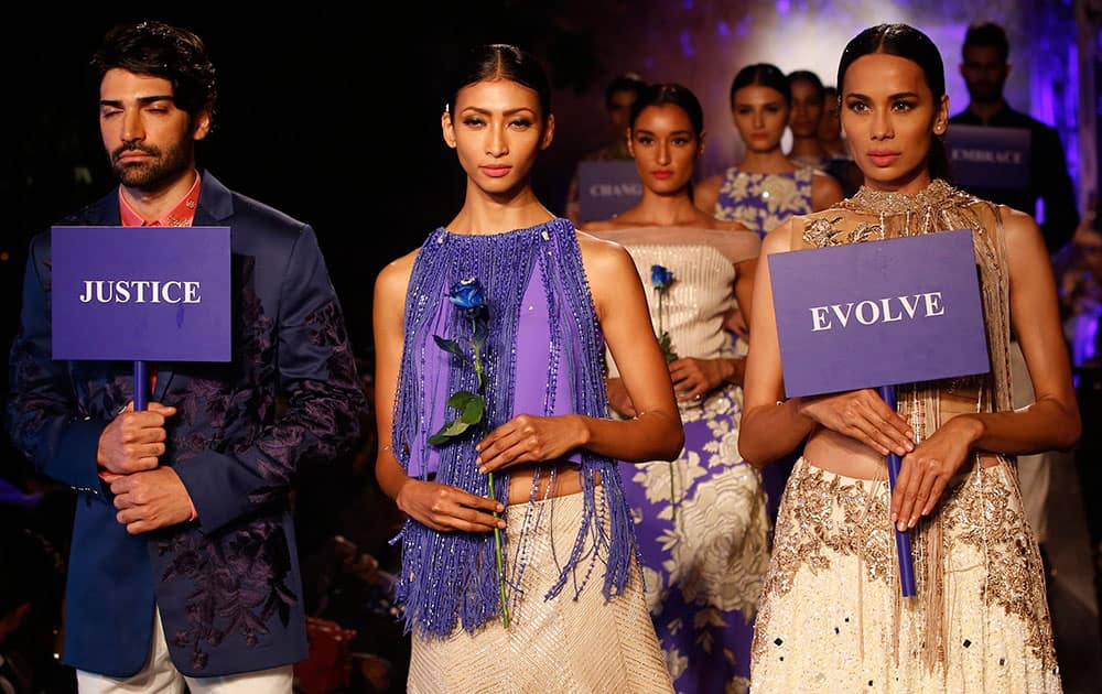 Models display creations by Manish Malhotra during the Lakme Fashion Week Summer Resort 2015 in Mumbai.