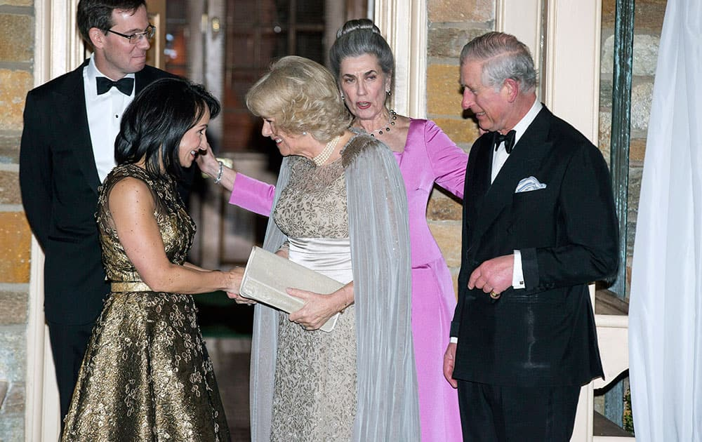 Britain's Prince Charles and his wife Camilla, the Duchess of Cornwall, are joined by Elena Allbritton, left, Robert Allbritton, second from left, and Barby Allbritton as they arrive for a reception in Washington.