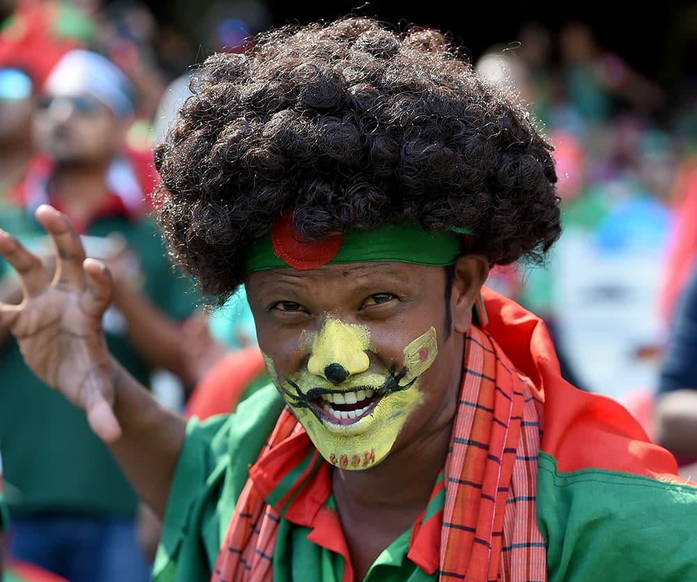 A Bangladesh fan cheers his team during their Cricket World Cup quarterfinal match against India in Melbourne, Australia.