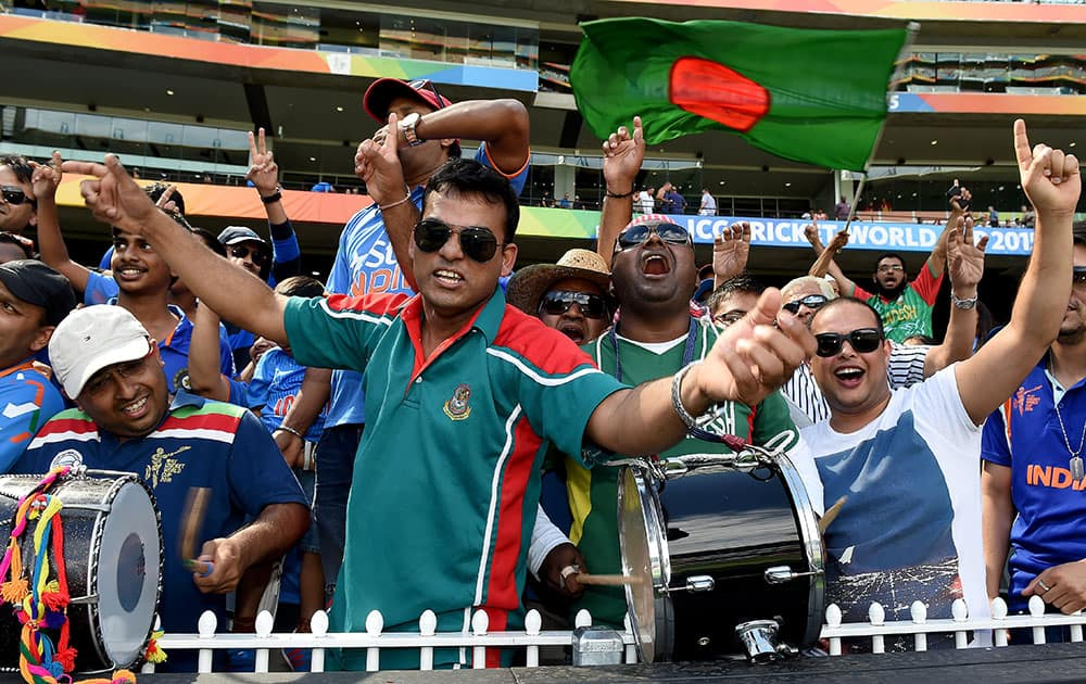 Bangladesh fans wave flags and cheer during their team's Cricket World Cup quarterfinal match against India in Melbourne, Australia.