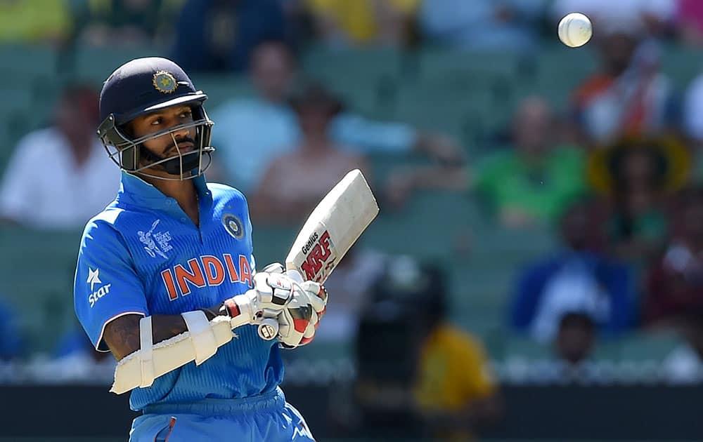 India's Shikhar Dhawan lets a ball pass while batting against Bangladesh during their Cricket World Cup quarterfinal match in Melbourne, Australia.