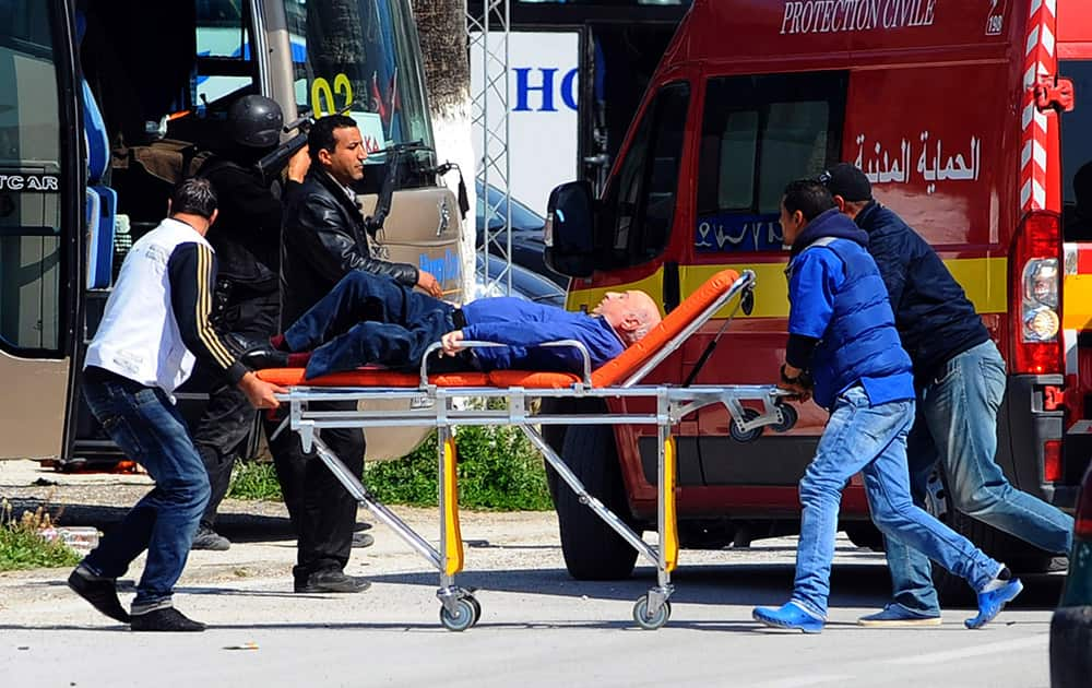 A man is evacuated outside the Bardo Museum after an attack on the museum by gunmen in Tunisia.