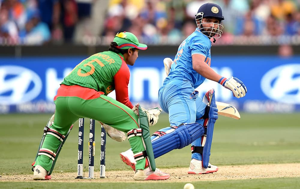 Ajinkya Rahane, watches the ball while batting against Bangladesh during their Cricket World Cup quarterfinal match in Melbourne.