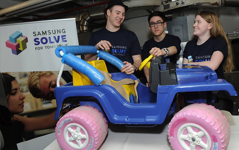 Students from Caesar Rodney High School, in Camden, Del., show how they reengineered a car to help children with developmental challenges at the Samsung Solve for Tomorrow National Finalist Pitch Event at the Intrepid Sea, Air & Space Museum, in New York.